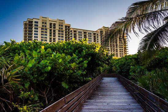 Boardwalk trail and hotel on Singer Island, Florida.