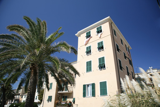 Expensive apartment building with palm trees Italian Riviera.